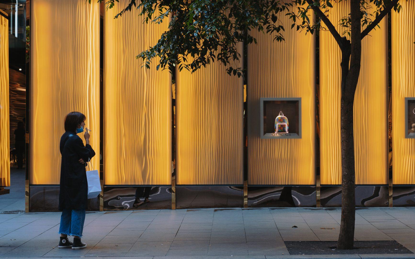 Women smoking looking at a handbag